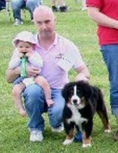 Baby Chloe at 10 Months with Dad Mervyn and Baby Amy at 12  Weeks in one of her First Fun Classes at the Bernese Mountain Dog Club of Great Britain  Garden Party  2007